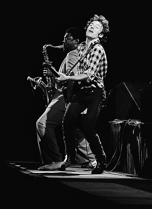 Caption: BListering- Springstein is joined by saxophonist Clarence Clemons on Forum stage.