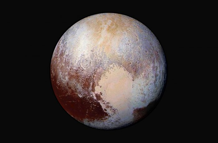 This NASA's photo of Pluto was made from four images from New Horizons' Long Range Reconnaissance Imager (LORRI) combined with color data from the Ralph instrument in this enhanced color global view released on July 24, 2015. The images, taken when the spacecraft was 280,000 miles (450,000 kilometers) away, show features as small as 1.4 miles (2.2 kilometers).     REUTERS/NASA/JHUAPL/SwRI/Handout  TPX IMAGES OF THE DAY  FOR EDITORIAL USE ONLY. NOT FOR SALE FOR MARKETING OR ADVERTISING CAMPAIGNS. THIS IMAGE HAS BEEN SUPPLIED BY A THIRD PARTY. IT IS DISTRIBUTED, EXACTLY AS RECEIVED BY REUTERS, AS A SERVICE TO CLIENTS